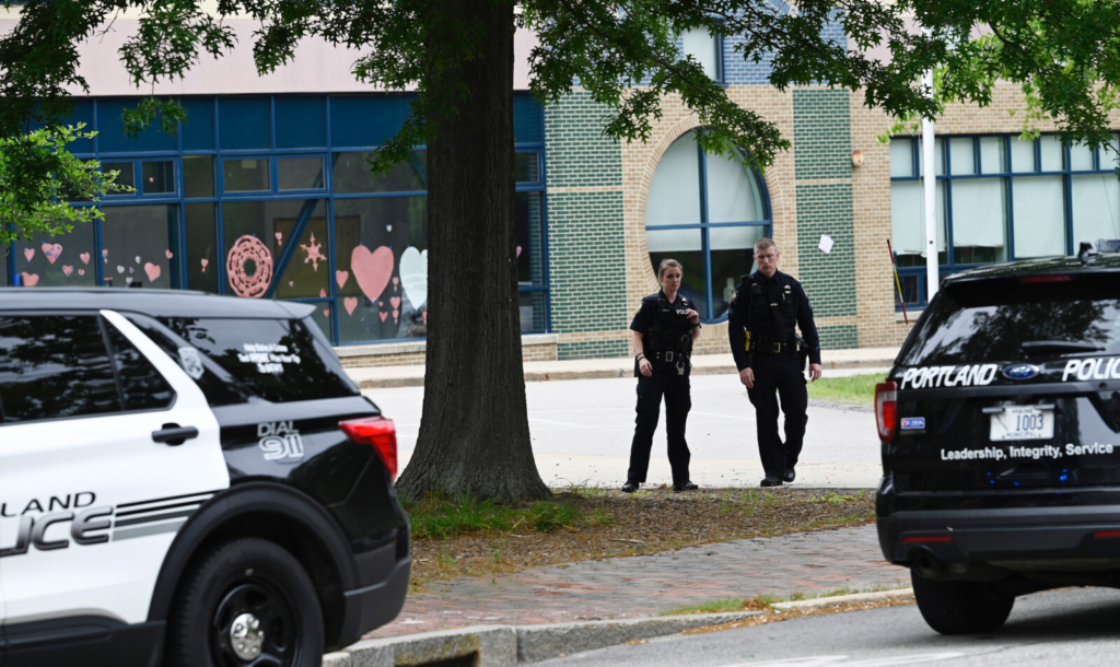 Police officers gathered outside King Middle School in Portland during a lockdown on Monday that was the result of a hoax.