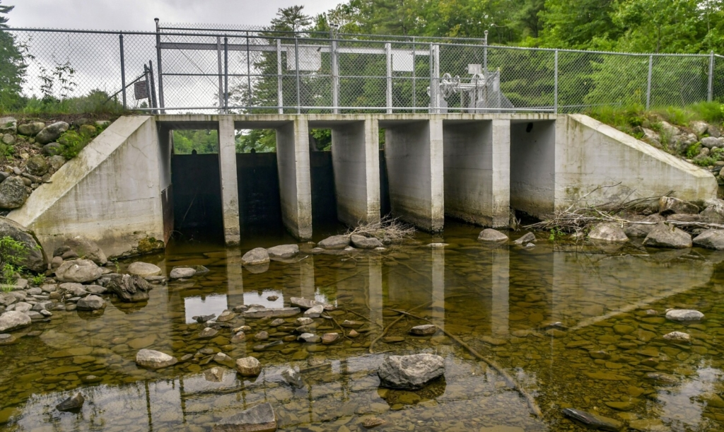 The dam at the east end of Woodbury Pond in Litchfield could soon undergo a temporary fix to stop a leak while the town works with engineers on a more permanent structural solution.