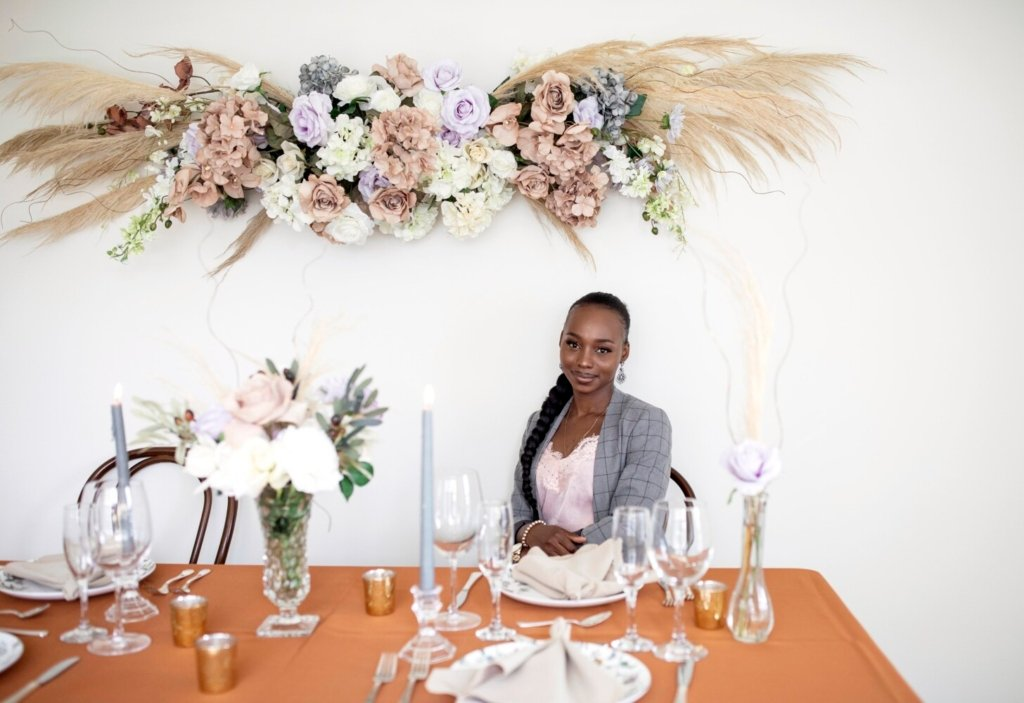 Deborah Bafongo poses with a floral and table arrangement she created. Bafongo started her event design company, Angels of Love, in 2019 and was hoping 2020 would be the year her business really got off the ground. When the pandemic hit, she applied for an interest-free loan, which helped her compensate for losses from a lack of weddings last year.