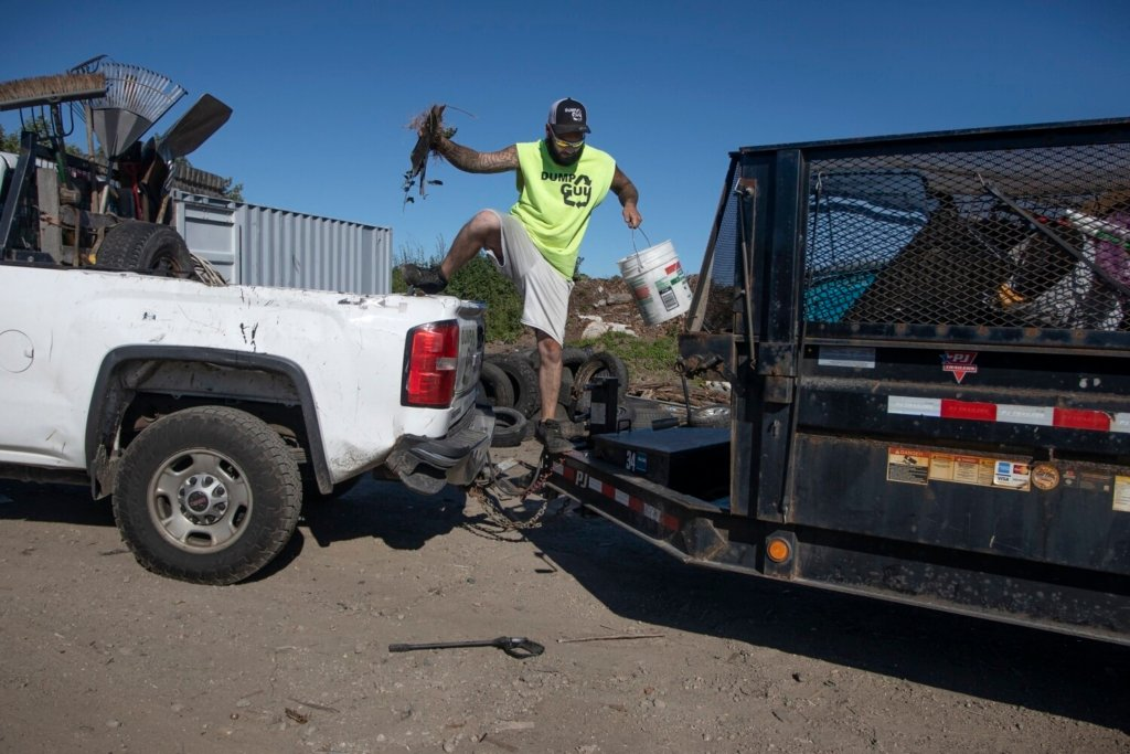 Phil Smith recently took a job at The Dump Guy because he wasn't getting enough hours at his previous position. He received a hiring bonus and the job includes benefits, all which help because he has three kids.