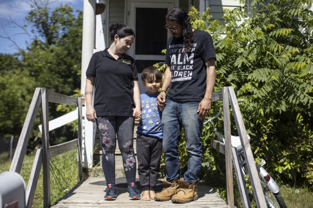 WATERVILLE, ME - JUNE 24: Michael Mosley, Desiree Mosley and their son Leander, 5, outside of their home in Waterville on Thursday, June 24, 2021. (Staff photo by Brianna Soukup/Staff Photographer)