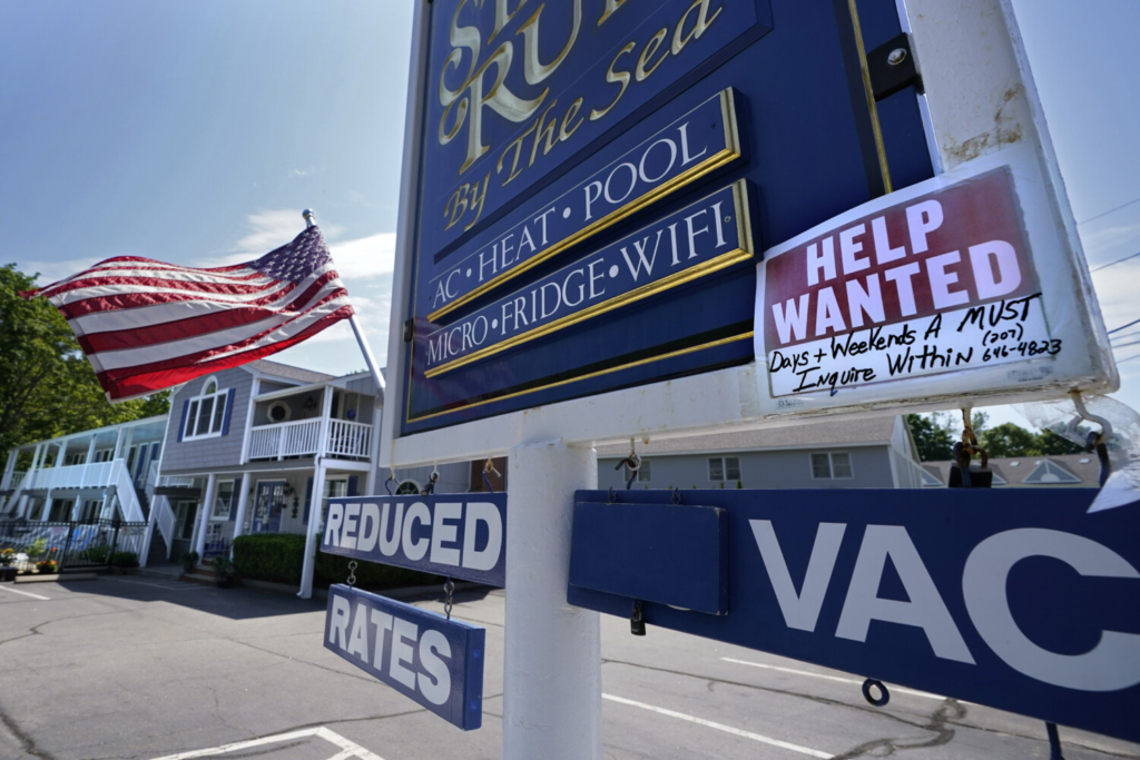 """A """"help wanted"""" sign is taped to a sign outside a motel late last month in Wells. Employers can get a $1,500 payment to be passed on to each eligible worker that starts a job between June 15 and the end of the month."""
