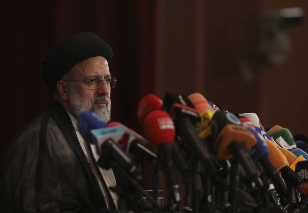Iran's President-elect Ebrahim Raisi at a press conference in Tehran on Monday. He promised to salvage the nuclear accord to secure relief from U.S. sanctions.