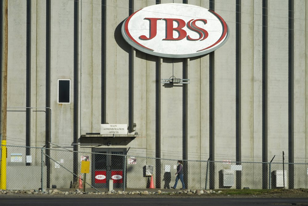 A worker goes into the JBS meatpacking plant in Greeley, Colo., on Oct. 12.