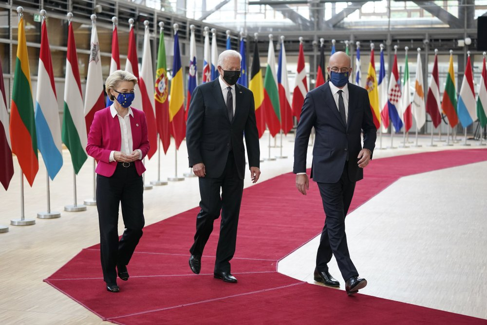 President Biden, center, walks with European Council President Charles Michel, right, and European Commission President Ursula von der Leyen during the United States-European Union Summit at the European Council in Brussels on Tuesday.