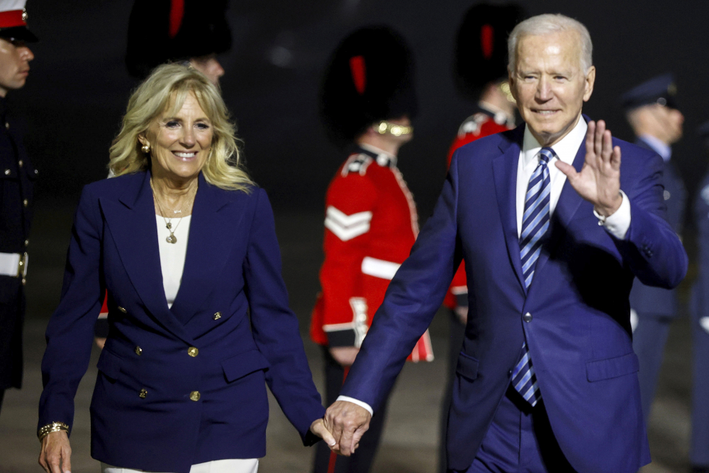 U.S. President Joe Biden and first lady Jill Biden arrive on Air Force One at Cornwall Airport Newquay, near Newquay, England, ahead of the G7 summit in Cornwall, early Thursday, June 10, 2021.