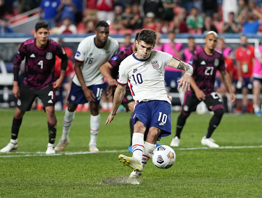 Christian Pulisic scores on a penalty kick against Mexico during extra time in the CONCACAF Nations League championship soccer match late Sunday night.