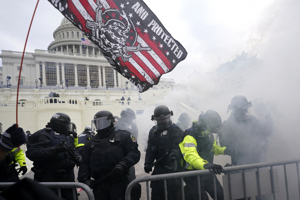 Police hold off supporters of Donald Trump who tried to break through a police barrier at the Capitol in Washington on Jan. 6.