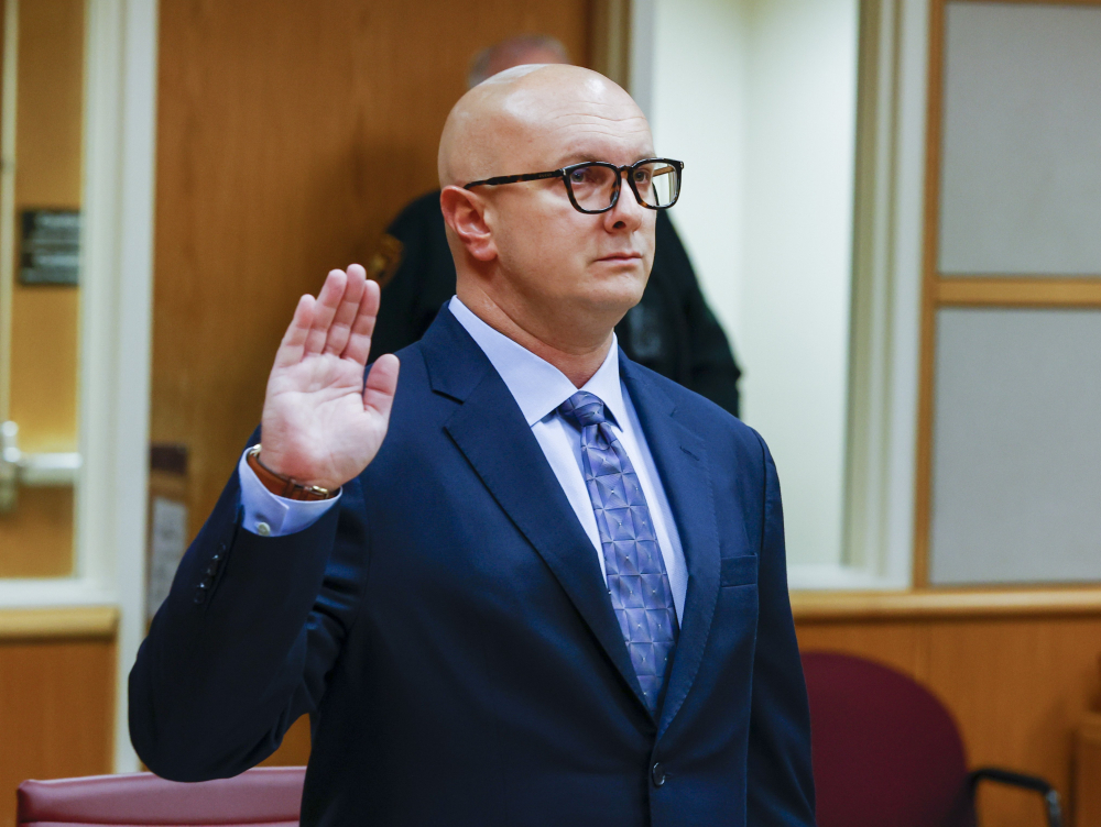 William Braddock raises his hand to take an oath during a hearing Tuesday in Clearwater, Fla. Anna Paulina Luna, who plans to run for Florida's District 13 congressional seat, contends in court documents that Braddock is stalking her and wants her dead. Luna has filed a petition for a permanent restraining order.  Braddock denies the claims and wants to see any evidence against him.