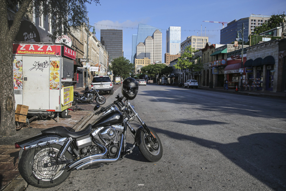 Some abandoned bikes are parked on the streets after an early morning shooting on Saturday, June 12 in downtown Austin, Texas.