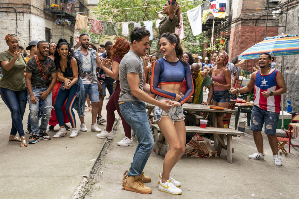 """Anthony Ramos, foreground left, and Melissa Barrera in a scene from """"In the Heights."""""""