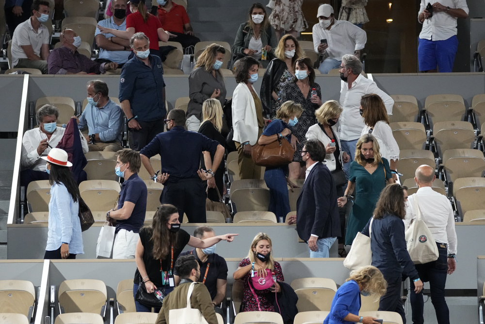 Spectators leave a French Open match in June in Paris in order to adhere to an 11 p.m. coronavirus curfew. European nations are employing a variety of requirements and limitations that pressure people to get vaccinated.