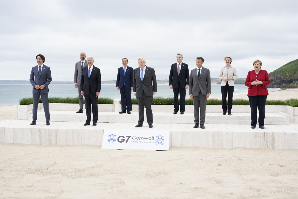 Leaders of the G-7 gather for a group photo overlooking the beach at the Carbis Bay Hotel in Cornwall, England, on Friday. From left are Canadian Prime Minister Justin Trudeau, European Council President Charles Michel, U.S. President Biden, Japan's Prime Minister Yoshihide Suga, British Prime Minister Boris Johnson, Italy's Prime Minister Mario Draghi, French President Emmanuel Macron, European Commission President Ursula von der Leyen and German Chancellor Angela Merkel.