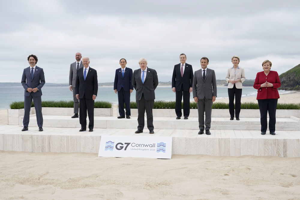 Leaders of the G7 pose for a group photo on overlooking the beach at the Carbis Bay Hotel in Carbis Bay, St. Ives, Cornwall, England, Friday, June 11. Leaders from left, Canadian Prime Minister Justin Trudeau, European Council President Charles Michel, U.S. President Joe Biden, Japan's Prime Minister Yoshihide Suga, British Prime Minister Boris Johnson, Italy's Prime Minister Mario Draghi, French President Emmanuel Macron, European Commission President Ursula von der Leyen and German Chancellor Angela Merkel.