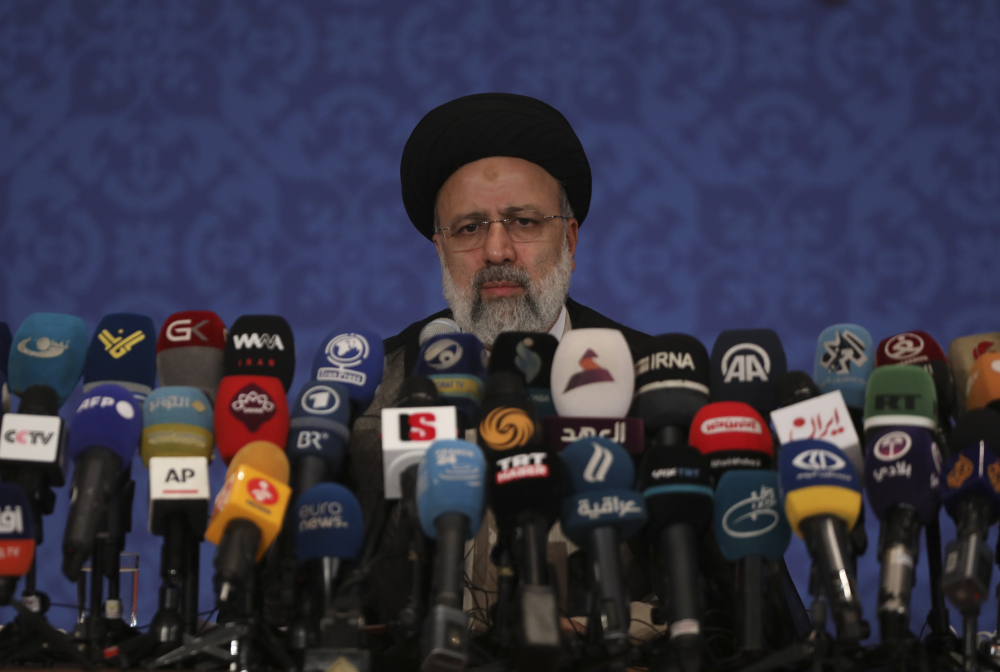 Iran's new President-elect Ebrahim Raisi gives a news conference in Tehran, Iran, on Monday.