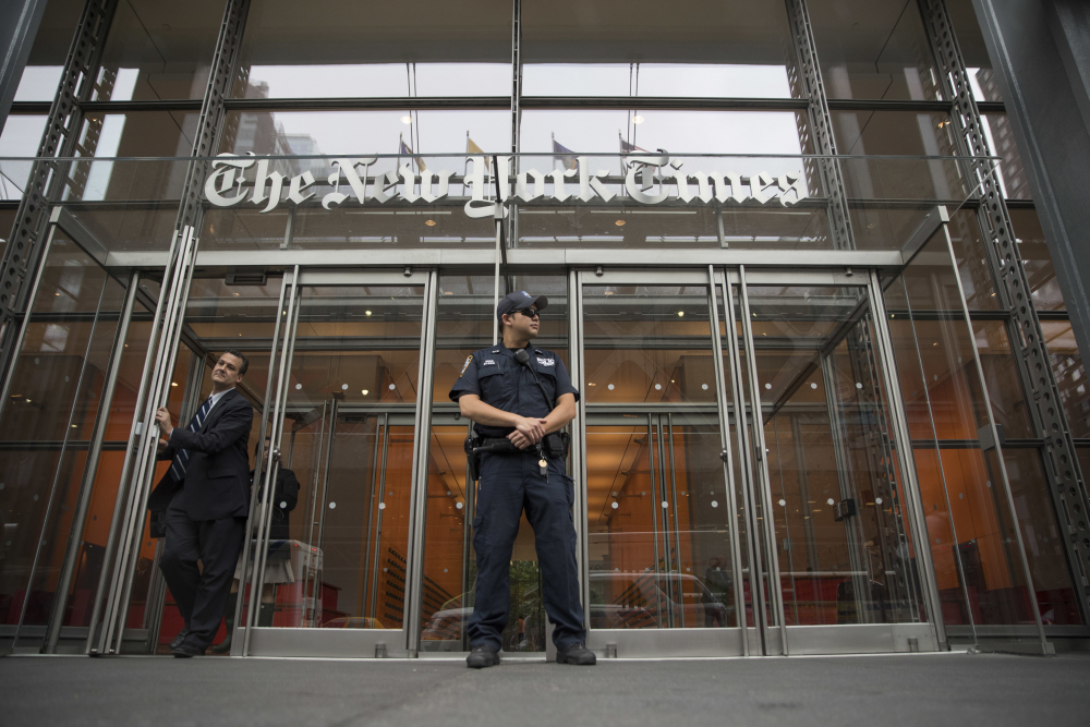 A police officer stands outside The New York Times building in New York in 2018.