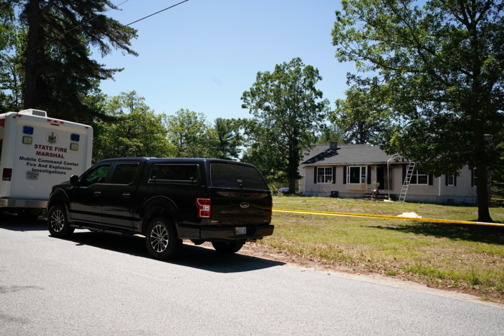 Police and fire investigators were gathered at a home on Hardscrabble Road in Limington where two adults were found dead and the building was damaged in a fire on Thursday morning.