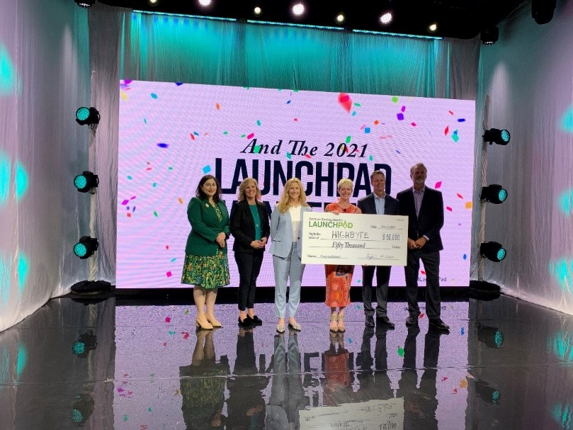 (From left) Contest judge Kate McAleer, emcee Michelle Neujahr, judge Catherine Cloudman, 2021 LaunchPad Winner Torey Penrod-Cambra of HighByte, president and CEO of Gorham Savings Bank Steve deCastro, and judge Ed McKersie.