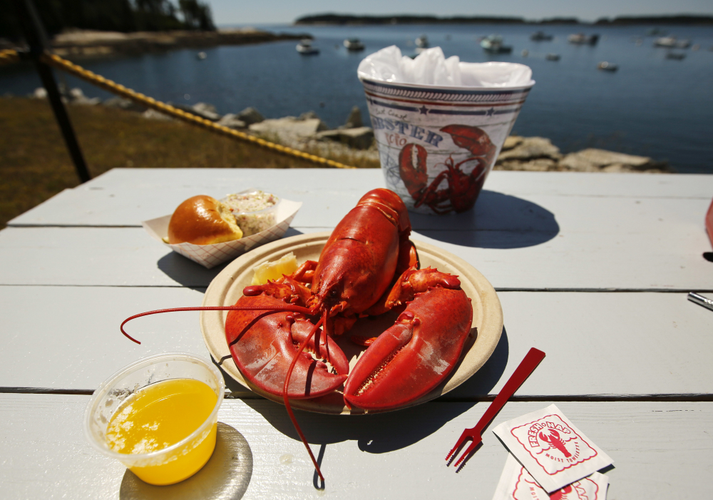 A lobster is served on the waterfront at McLoon's Lobster Shack in Spruce Head in 2018.