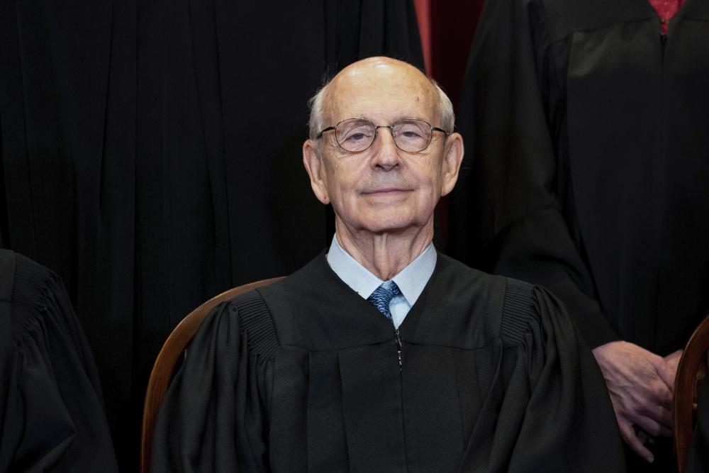 Supreme Court Associate Justice Stephen Breyer sits during a group photo at the Supreme Court in Washington in April 2021.