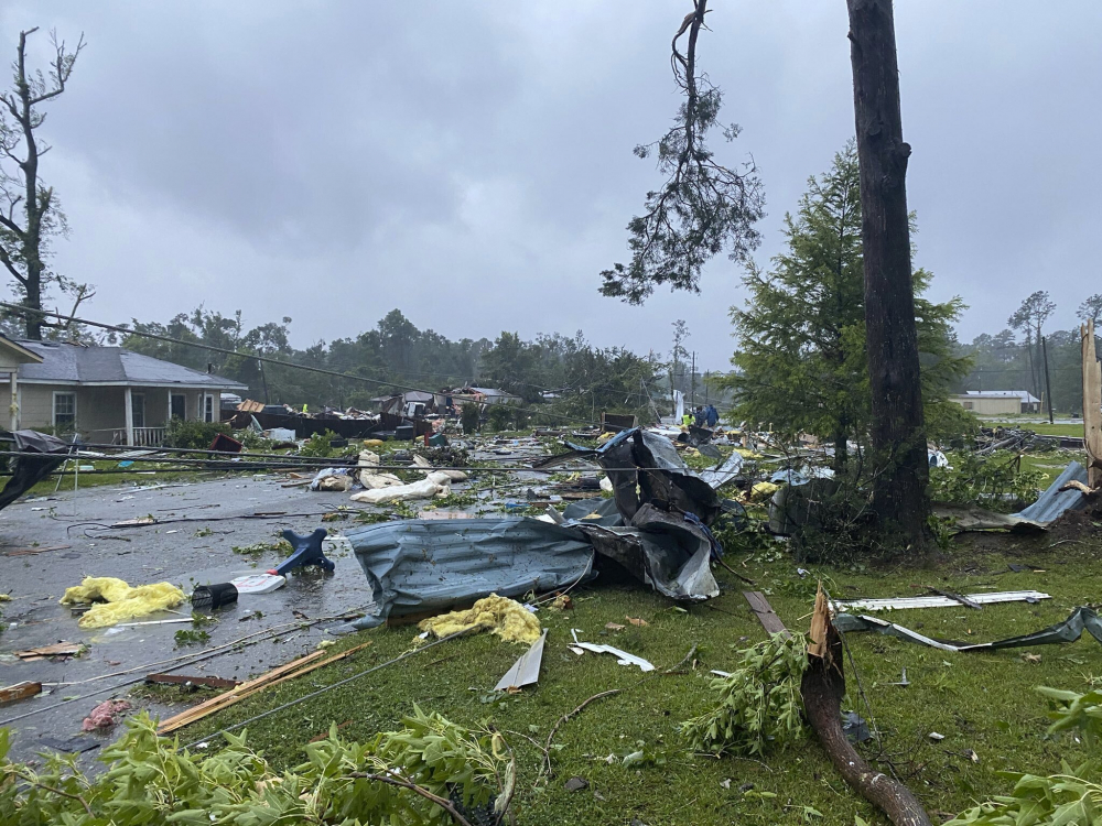 Debris covers the street in East Brewton, Ala., on Saturday.  Authorities in Alabama say a suspected tornado spurred by Tropical Storm Claudette demolished or badly damaged at least 50 homes in the small town just north of the Florida border.