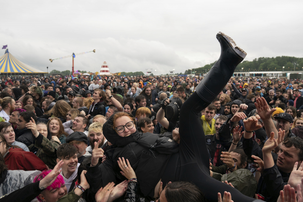 A festivalgoer crowd-surfs on the first day of Download Festival at Donington Park at Castle Donington, England, on Friday.