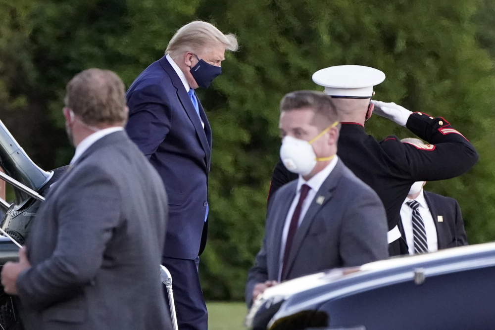 Then President Trump arrives at Walter Reed National Military Medical Center, in Bethesda, Md., on the Marine One helicopter after he tested positive for COVID-19 in October 2020. Records show that roughly 900 U.S. Secret Service employees tested positive for the coronavirus during the year beginning March 1, 2020.