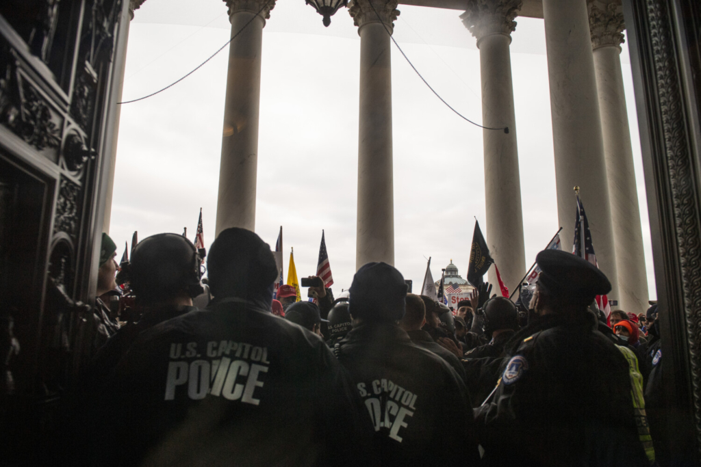 A pro-Trump mob fights to gain access to the U.S. Capitol on Jan. 6. At least seven congressional committees have launched probes into aspects of the attack.