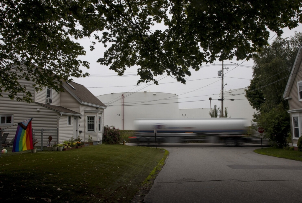 A fuel tanker passes homes at the intersection of Elm and Palmer streets in South Portland last week.