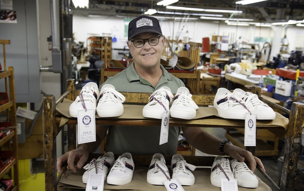 Mike Rancourt, owner of Rancourt & Co., displays a rack of shoes Wednesday that were handmade at the Lewiston business for members of the U.S. Olympic team to wear during opening and closing ceremonies in Tokyo on July 23 and Aug. 8.