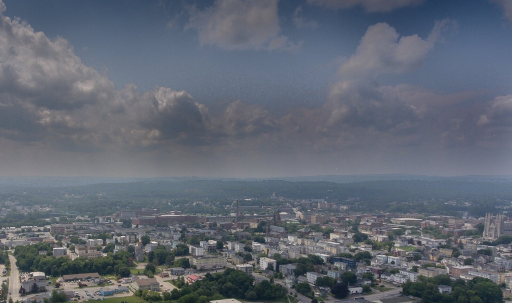 An aerial photo looking west over Lewiston and Auburn shows the haze in the air that has been attributed to western wildfires as seen in this aerial photo from July 21, 2021.
