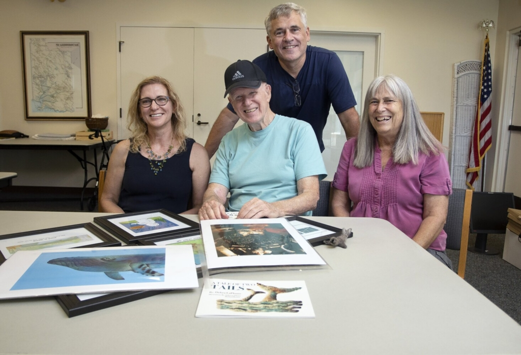 SCARBOROUGH, ME - JULY 22: Illustrator Michael David Brown, seated, and other members of the Scarborough Public Library Sketching Group, Debra LaPlante, left,, Pat Scammon, and John Girard. The artists will be exhibiting and selling their works at an event the library is hosting Saturday. (Staff photo by Derek Davis/Staff Photographer)