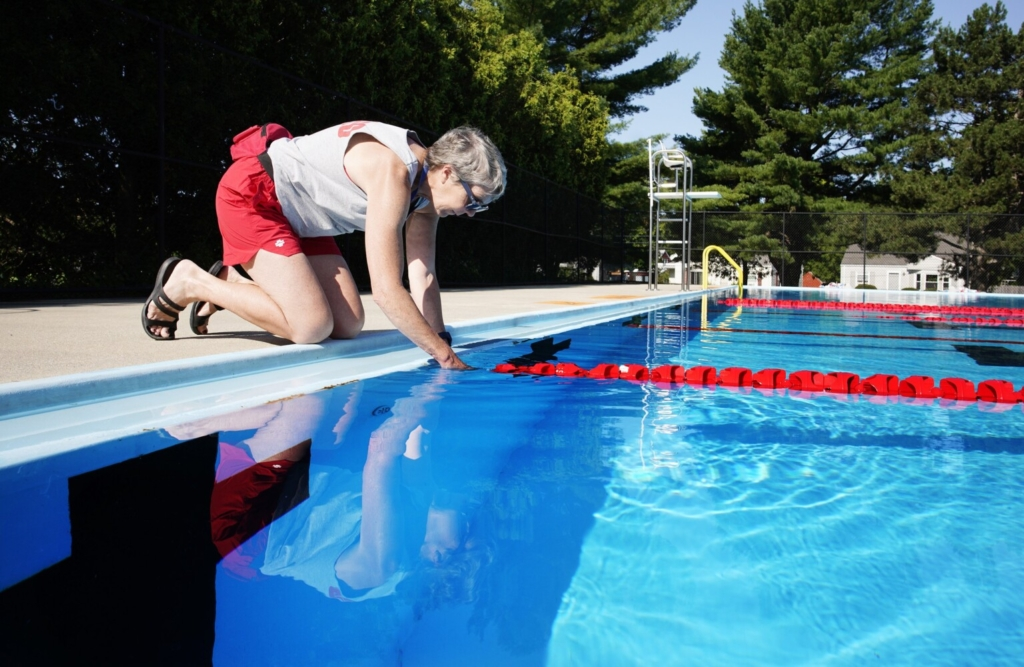 Barbara Linnehan-Smith disconnects a lane divider at the Kiwanis Pool in Portland on Friday. She has been a lifeguard for 50 years.