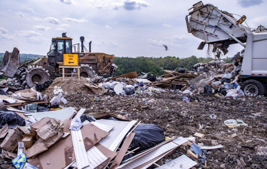 A garbage truck dumps a load at Hatch Hill landfill July 27 in Augusta.
