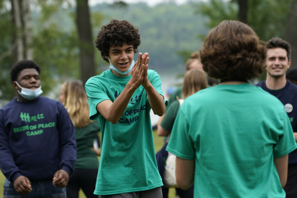Camper Joel Kalai, of Lexington, Mass., takes part in a game at the Seeds of Peace summer camp Monday in Otisfield.