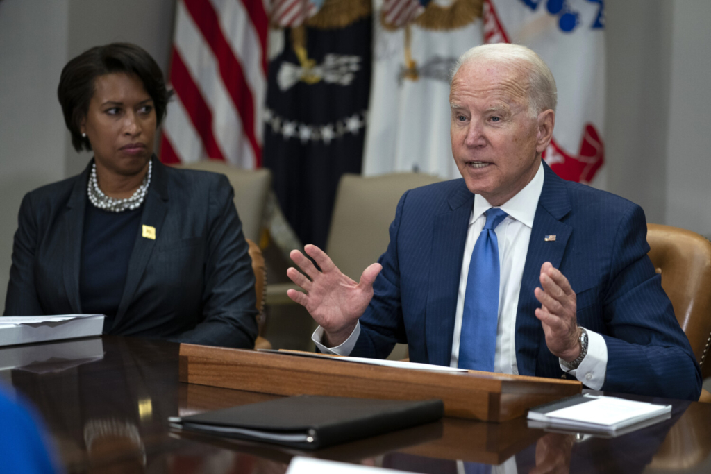 Washington Mayor Muriel Bowser listens as President Biden speaks during a meeting on reducing gun violence, in the Roosevelt Room of the White House on Monday in Washington.