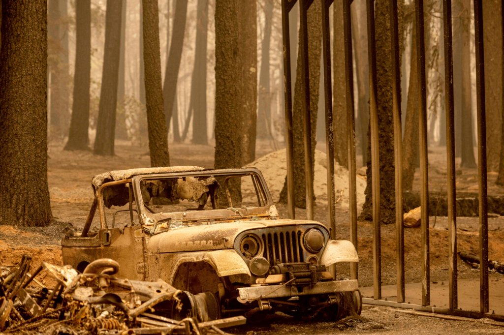 Following the Dixie Fire, a scorched Jeep rests in the Indian Falls community of Plumas County, Calif., on Monday. The blaze is 22 percent contained.