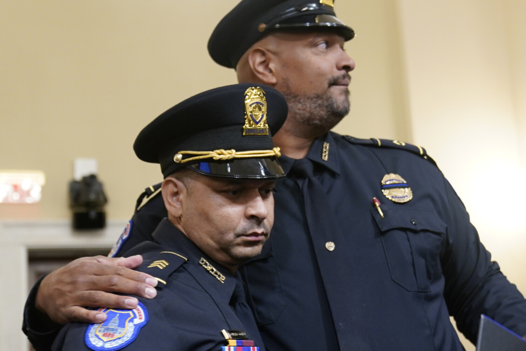 U.S. Capitol Police Sgt. Aquilino Gonell left, and U.S. Capitol Police Sgt. Harry Dunn stand after the House select committee hearing on Tuesday on the Jan. 6 attack on Capitol Hill.