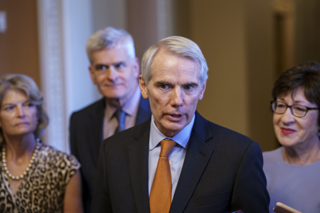 Sen. Rob Portman, R-Ohio, the lead Republican negotiator in the infrastructure talks, is joined by, from left, Sen. Lisa Murkowski, R-Alaska, Sen. Bill Cassidy, R-La., and Sen. Susan Collins, R-Maine, as he announces an agreement with Democrats on a $1 trillion infrastructure bill, saying they are ready to vote to take up the bill, at the Capitol in Washington, on Wednesday.