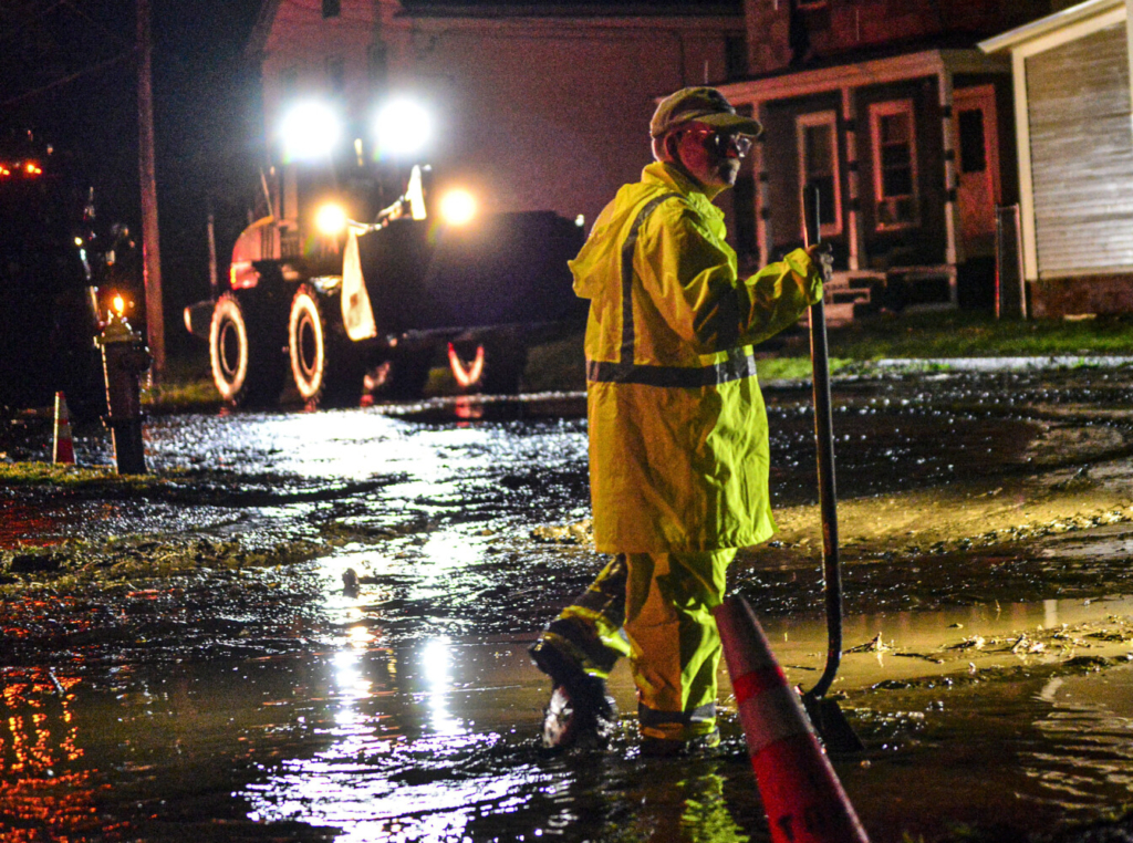 Crews clean up mud and debris in Bellows Falls, Vt., after flooding from a storm that dumped several inches of rain on Thursday.
