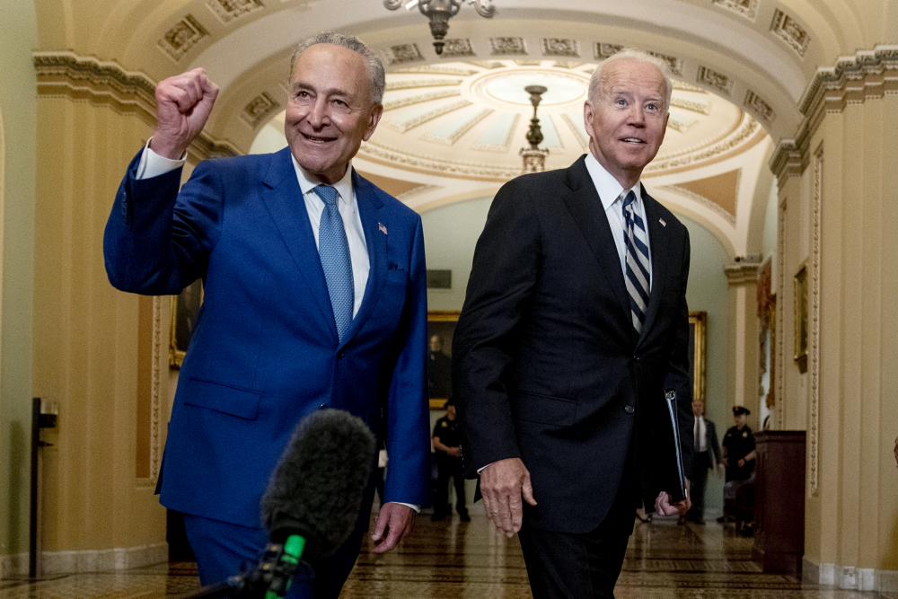 President Biden joins Senate Majority Leader Chuck Schumer, D-N.Y., and fellow Democrats at the Capitol in Washington on Wednesday to discuss the latest progress on his infrastructure agenda.