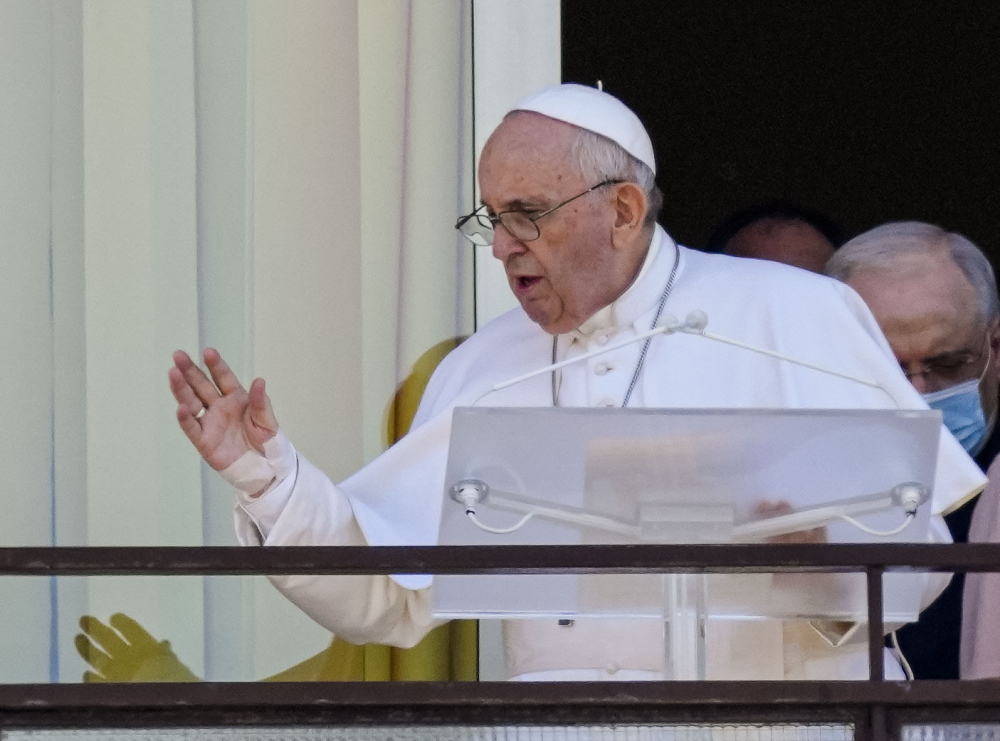 Pope Francis appears on a balcony of the Agostino Gemelli Polyclinic in Rome on Sunday for the traditional Sunday blessing and Angelus prayer.