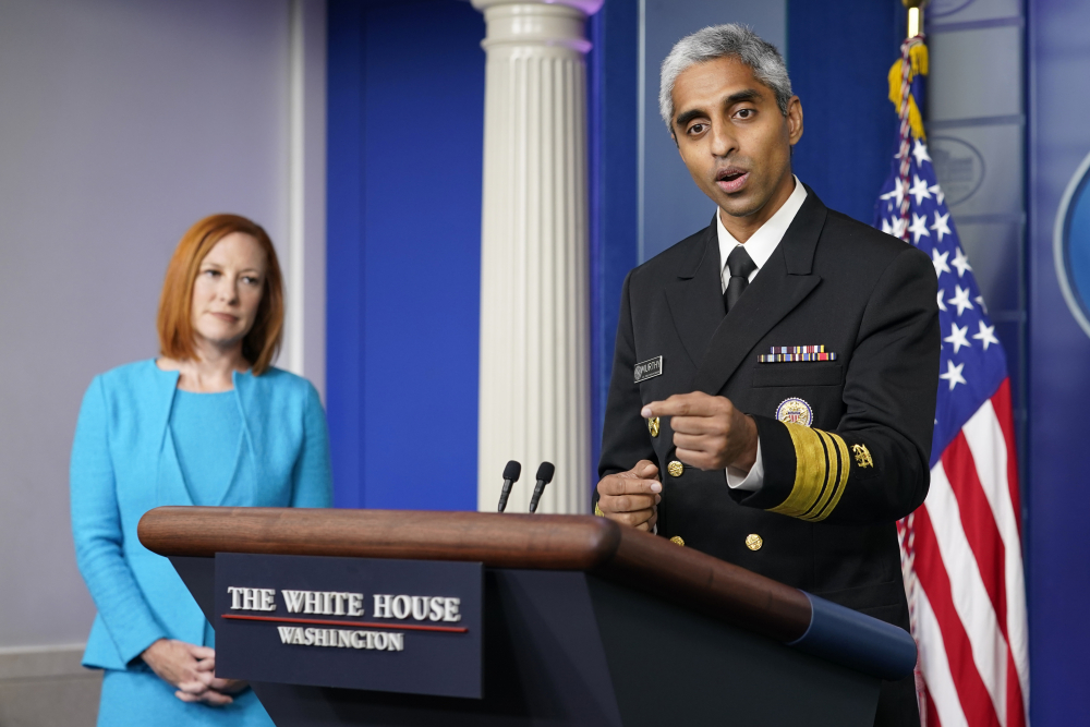 Surgeon General Dr. Vivek Murthy speaks during the daily briefing at the White House in Washington on Thursday. White House press secretary Jen Psaki is at left.