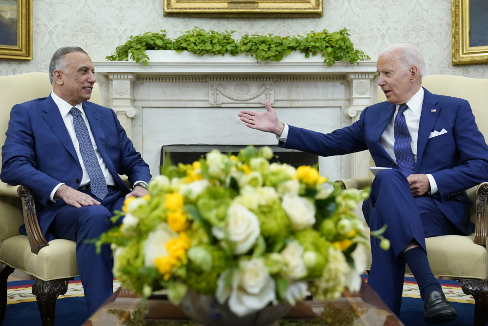 """President Biden and  Iraqi Prime Minister Mustafa al-Kadhimi in the Oval Office on Monday. """"Our shared fight against ISIS is critical for the stability of the region and our counterterrorism operation will continue, even as we shift to this new phase we're going to be talking about,"""" Biden said."""
