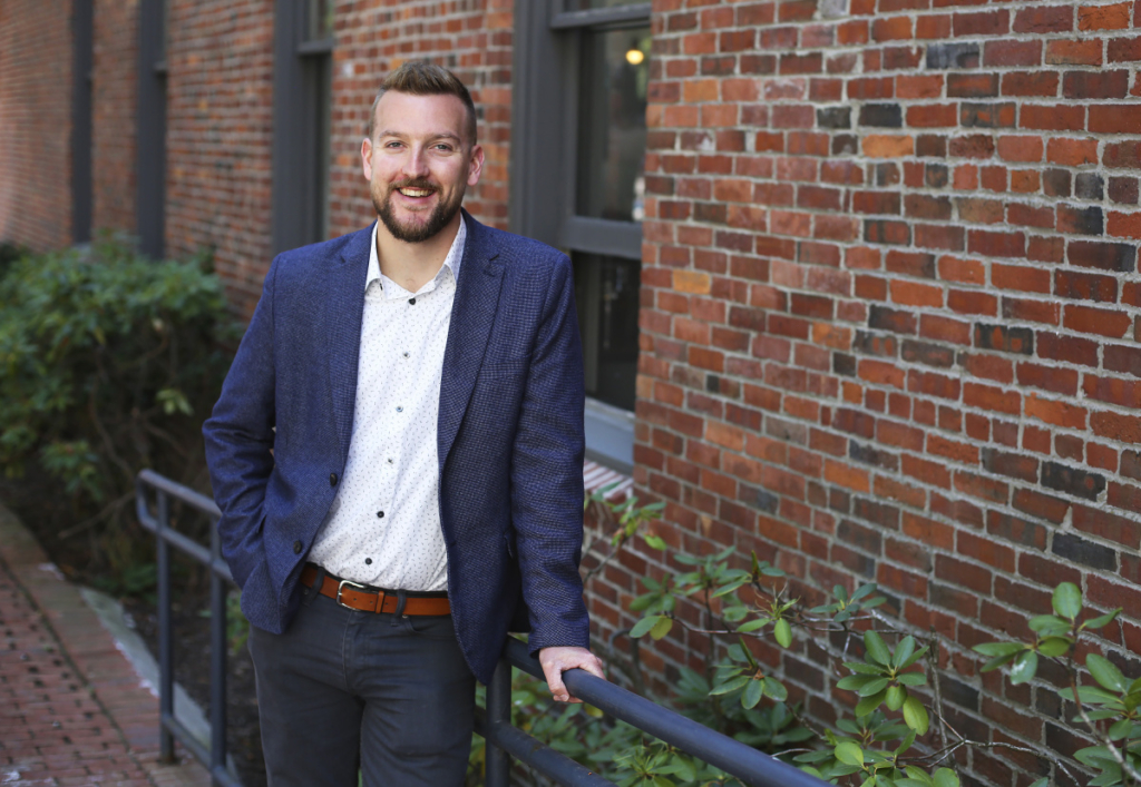 Brian Harris, co-founder and CEO of Portland-based MedRhythms, poses in front of the company's headquarters in this Press Herald file photo from 2018. The company has secured $25 million in venture capital funding to expand its operations.