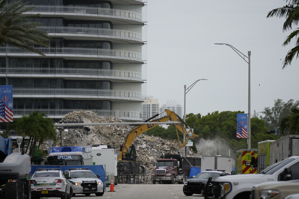 An excavator removes the rubble of the demolished section of the Champlain Towers South building on July 12.