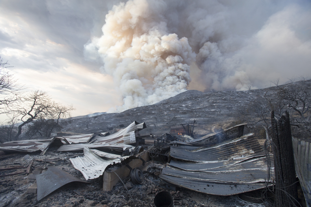 The remains of a  structure burned by a wildfire in Yucaipa, Calif. in 2020.