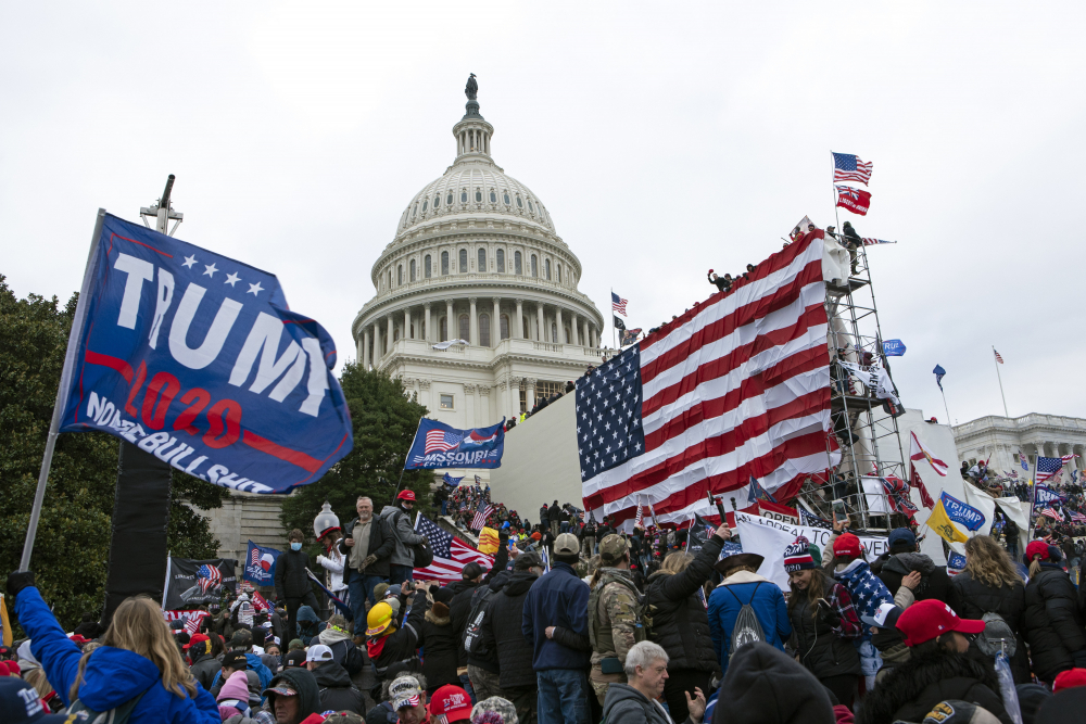Rioters loyal to then-President Donald Trump outside the U.S. Capitol on Jan. 6 in Washington. Scores of suspects remain unidentified, reflecting the massive scale of the Justice Department's investigation and the grueling work authorities still face to track everyone down.