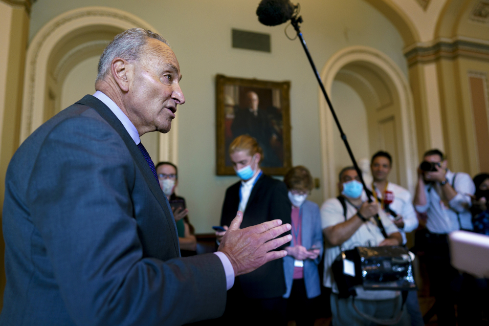 Senate Majority Leader Chuck Schumer, D-N.Y., updates reporters on the infrastructure negotiations between Republicans and Democrats, at the Capitol in Washington on Wednesday.