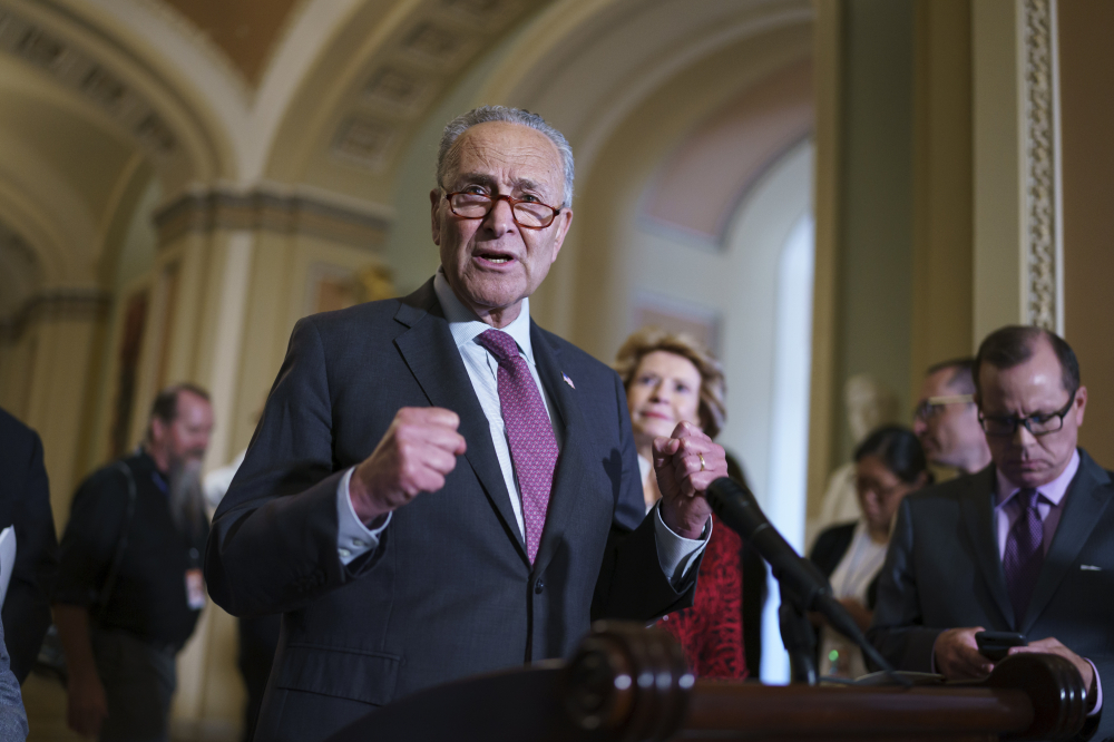 Senate Majority Leader Chuck Schumer, D-N.Y., shown Tuesday in Washington, told  Democratic colleagues to remain united as they draft a multitrillion-dollar package of once-in-a-generation investments for the nation that are the top priority for the president and his party.